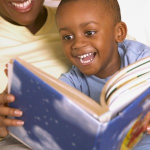 child reading with adult